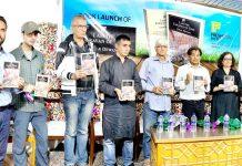 Dignitaries releasing novel at Srinagar on Sunday.