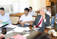 Advisor to Governor Khurshid Ahmad Ganai chairing a meeting at Srinagar on Tuesday.