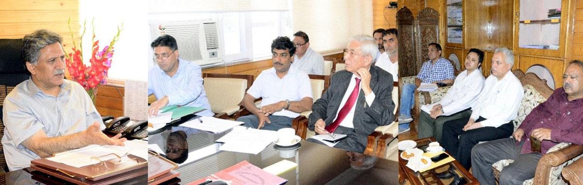 Advisor to Governor Khurshid Ahmad Ganai chairing a meeting at Srinagar on Tuesday.