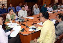 Advisors K Skandan and Vijay Kumar chairing a meeting at Srinagar on Thursday.