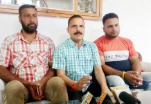 Balwant Singh Mankotia addressing a press conference at Udhampur on Tuesday.