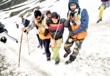 Mountain Rescue Team assisting pilgrims during Amarnath Yatra.