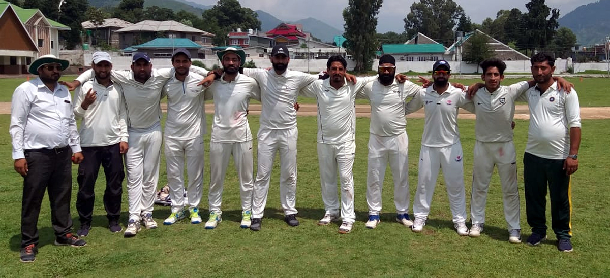 Winners posing for a group photograph during a match of JKCA Tournament at Poonch on Monday.