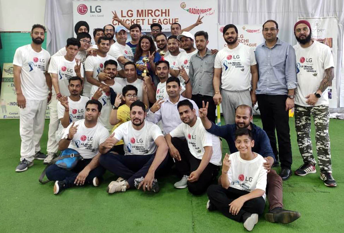 Players of jubilant Media XI Cricket Club posing for a group photograph after registering win in LG Mirchi Cricket League 2019 at KCSC in Jammu.