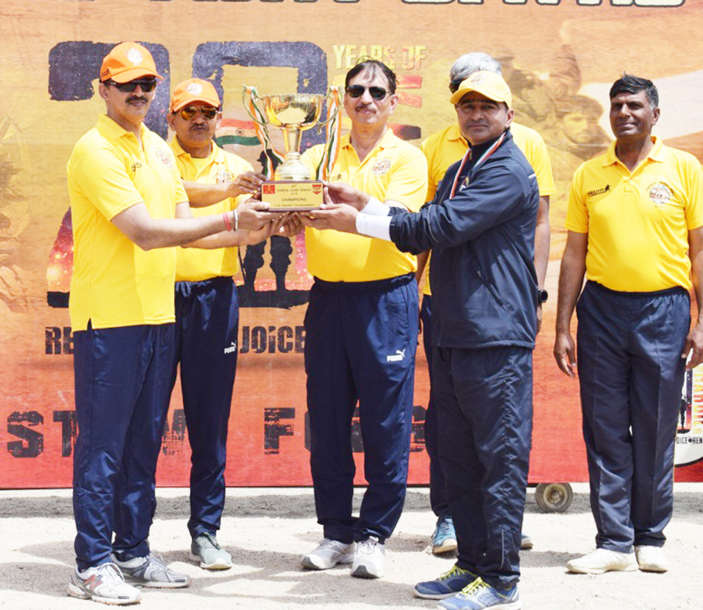 Winners of T20 Cricket Tournament being presented trophy in Leh.