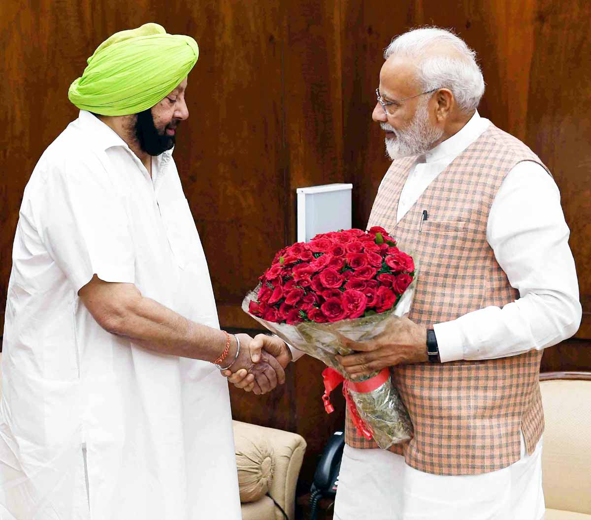 Punjab Chief Minister Capt. Amrinder Singh calling on Prime Minister Narendra Modi, in New Delhi on Monday. (UNI )