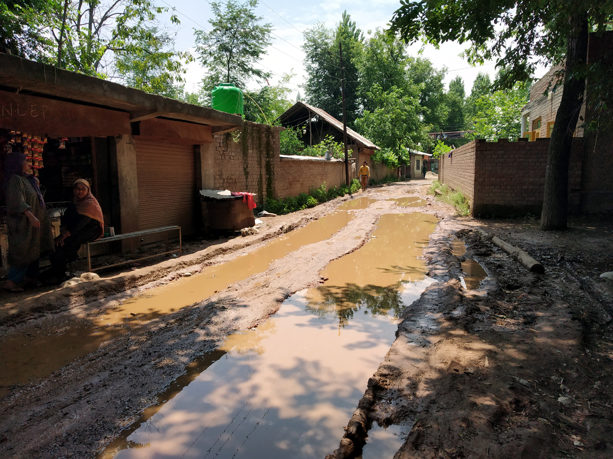 Dilapidated condition of road in Alipora village of Budgam.
