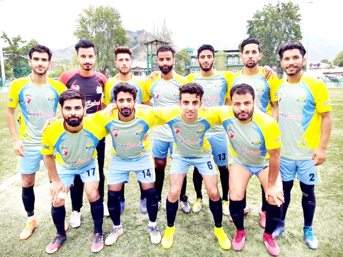 Footballers posing for a group photograph in Srinagar.