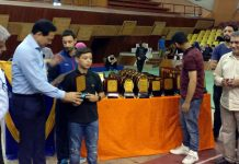 A player revives after winning Badminton championship in Srinagar. —Excelsior/Rehman