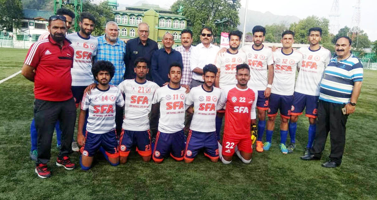 J&K Bank team posing for a photograph alongwith officials at the inaugural function of Football Premier League in Srinagar.