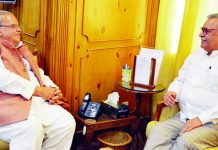Governor Satya Pal Malik meeting newly appointed Advisor Farooq Khan on Tuesday.