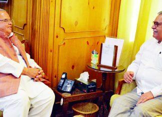 Governor Satya Pal Malik meeting newly appointed Advisor Farooq Khan on Tuesday.