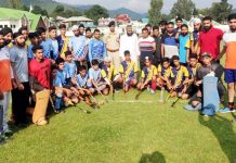 Teams posing for a group photograph during inaugural match of Poonch Hockey League in Poonch on Monday.