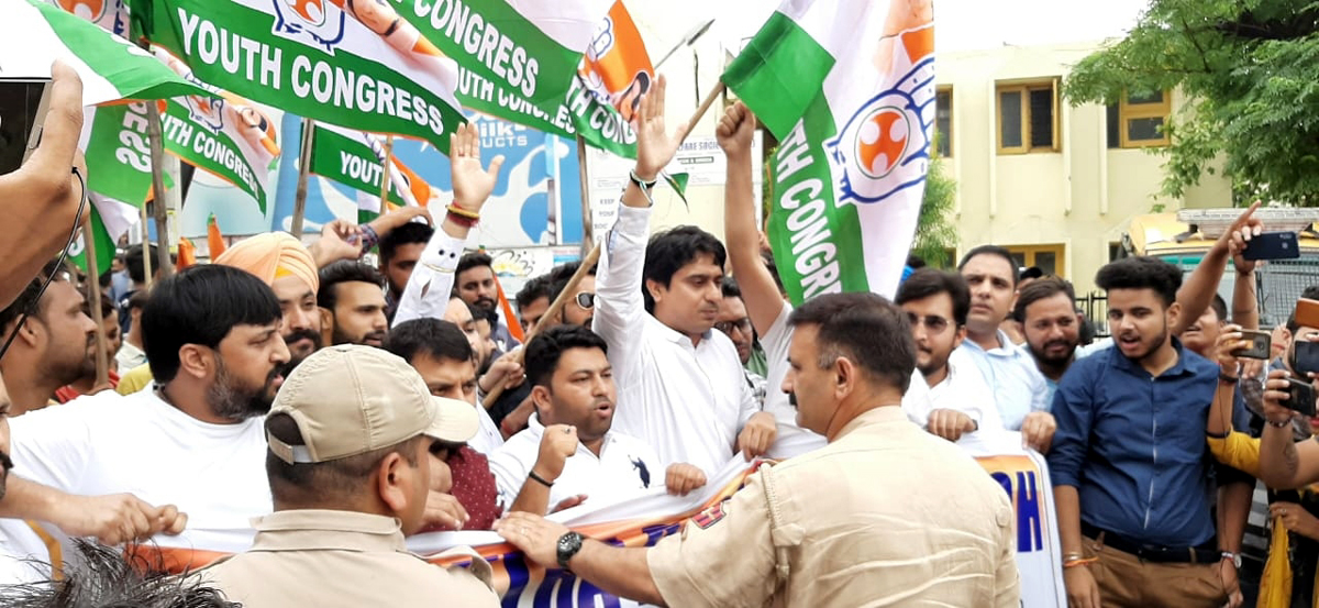 Youth Cong activists staging protest near BJP office in Jammu on Tuesday.