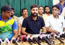 International Cricketers Parvez Rasool addressing media persons in Srinagar on Tuesday.