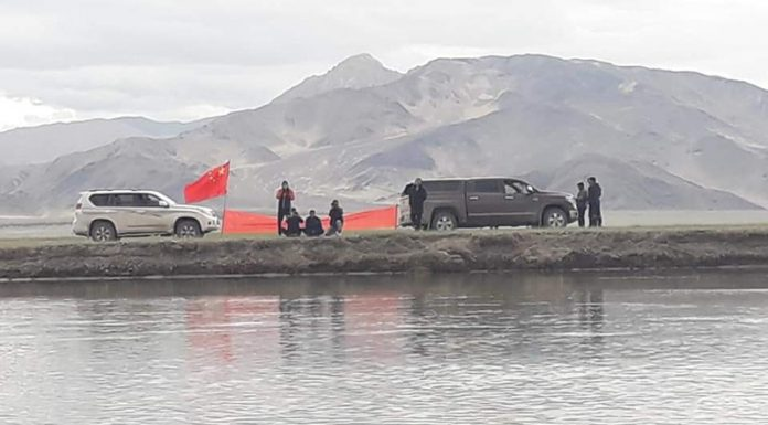 Chinese troops in civil dresses with their flag across Nullah in Demchok area of Eastern Ladakh sector.
