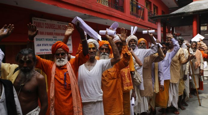 Sadhus standing in queue at registration counter in Ram Mandir, Purani Mandi on Friday.