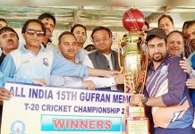 Winners of Gufran Memorial T20 Championship posing for a group photograph along with dignitaries at Sports Stadium in Doda.