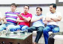 President and members of Yoga Association during a meeting in Jammu.