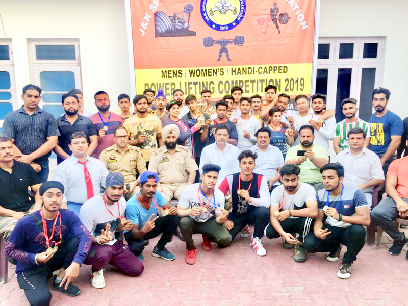Winners of the State level Powerlifting Championship posing along with dignitaries and officials at Jammu.