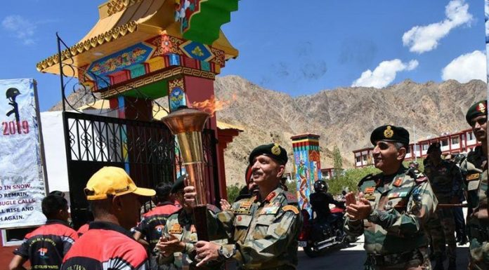 'Kargil Victory Flame' being received by the Army officials at Leh on Wednesday.