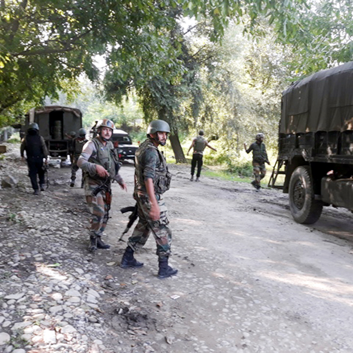 Troops at the site of encounter at Bijbehara, Anantnag on Tuesday. -Excelsior/Sajjad Dar