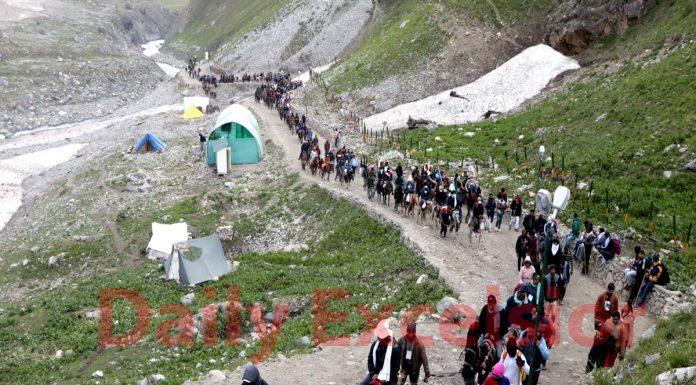 A convoy of pilgrims crossing Trail Pathri ridges on way to holy cave shrine of Amarnathji on Monday.