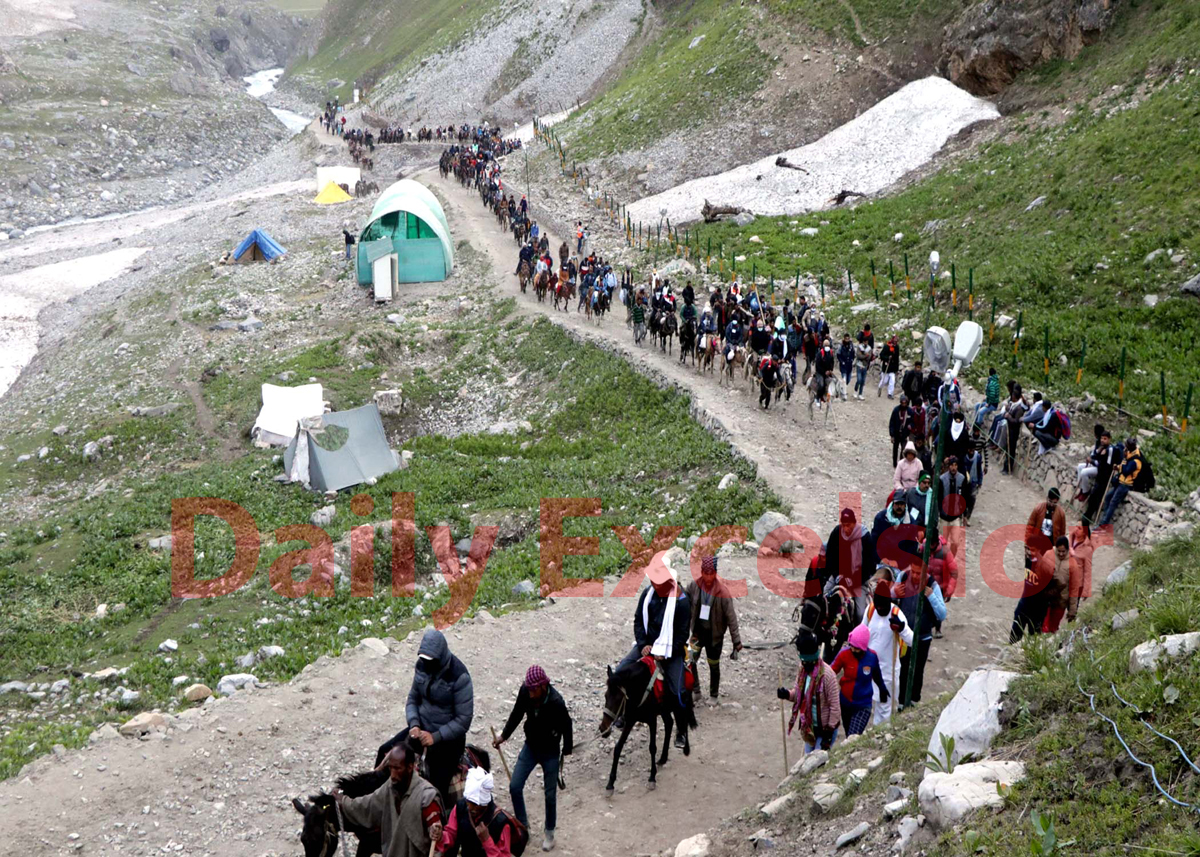 A convoy of pilgrims crossing Trail Pathri ridges on way to holy cave shrine of Amarnathji on Monday.
