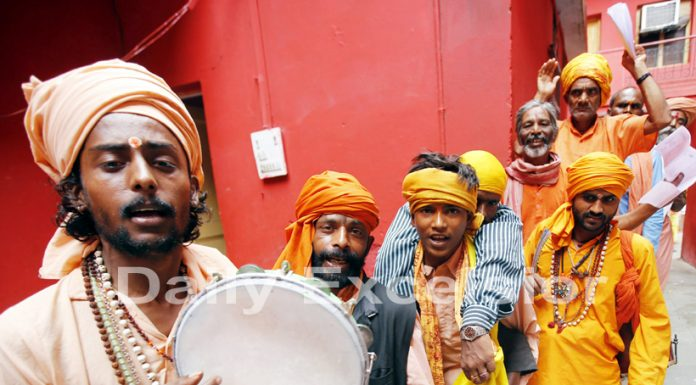 Shri Amarnathji bound sadhus singing bhajans at Purani Mandi temple on Thursday. -Excelsior/Rakesh