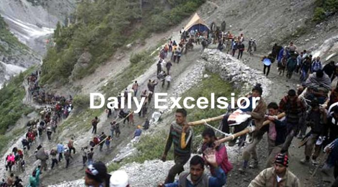 Amarnath yatris heading towards holy cave. -Excelsior/Sajjad Dar