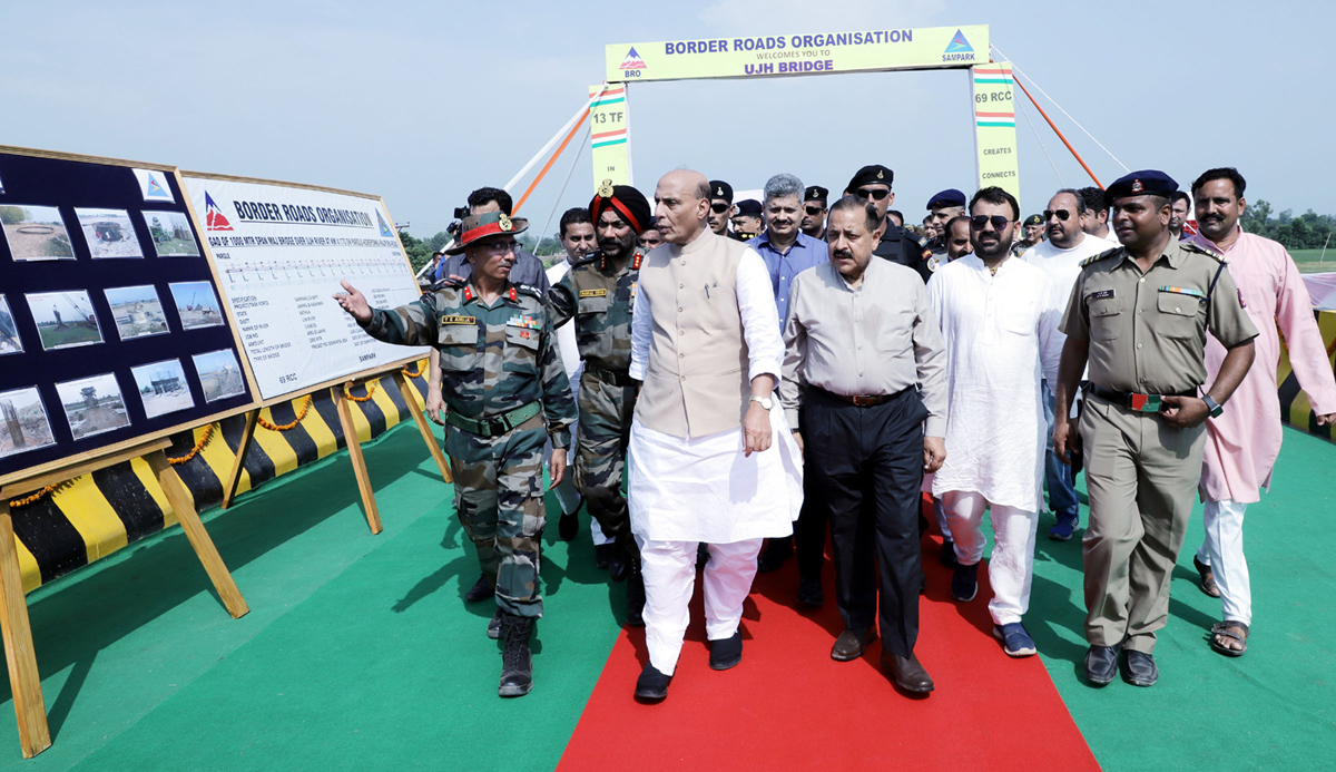 Defence Minister Rajnath Singh and Union MoS in PMO Dr Jitendra Singh walk over Ujh bridge in Kathua district after inauguration on Saturday.