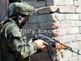 A jawan takes position during encounter in Sopore on Wednesday. -Excelsior/Aabid Nabi