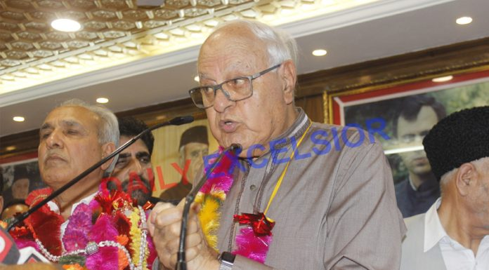 NC president Dr Farooq Abdullah speaking at party headquarters in Srinagar on Sunday. —Excelsior/Shakeel