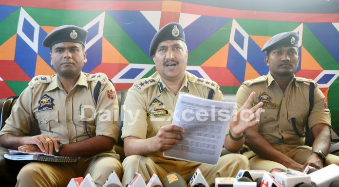 SSP Srinagar Dr Haseeb Mughal addressing a press conference in Srinagar on Tuesday. -Excelsior/Shakeel