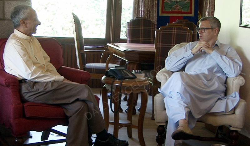 Omar meets Dineshwar Sharma in Srinagar on Wednesday.