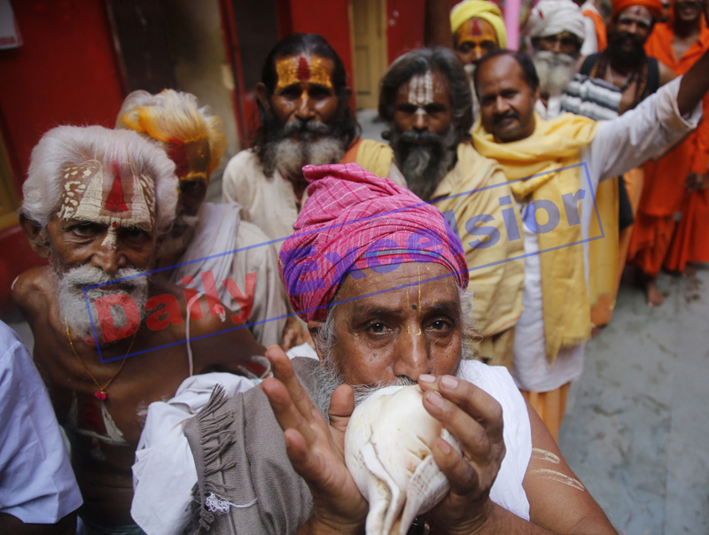 A Swami Amarnath bound Sadhu blowing a conch in front of a registration camp at Jammu on Monday. —Excelsior/Rakesh