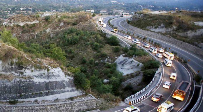 Shri Amarnath yatra vehicles move on Jammu-Srinagar National Highway. -Excelsior/Rakesh