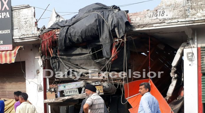A truck which rams into a shop housing J&K Bank ATM in Chhani Himmat area of Jammu. -Excelsior/Rakesh
