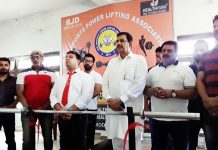 Dignitaries watching the proceedings during Weightlifting Championship organised by J&K Sports Powerlifting Association in Jammu.