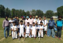 Winners Srinagar Academy team posing along with visiting guests and officials at Government Degree College ground, Srinagar.