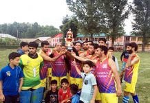 Unanimous Club receiving title trophy at Degree College ground Anantnag.