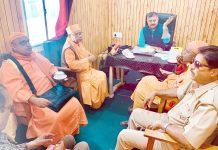 Saints of Ramakrishna Mission during a meeting with Camp Director, Nunwan Base Camp, Amit Sharma.