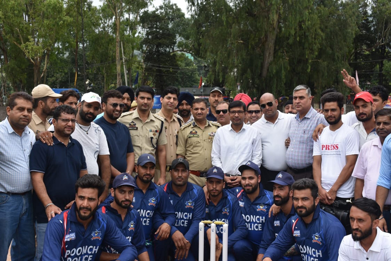 Winners posing along with dignitaries on the inaugural day of Police Martyrs T20 Cricket Tournament in Poonch.