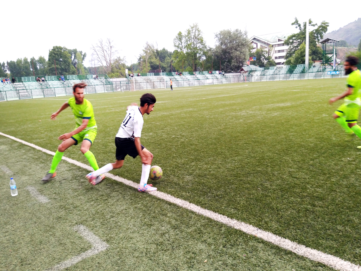 Players in action during a Football match at TRC in Srinagar on Friday.
