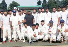 Winners posing for a group photograph during JKCA District Poonch Cricket Tournament at Sports Stadium in Poonch.
