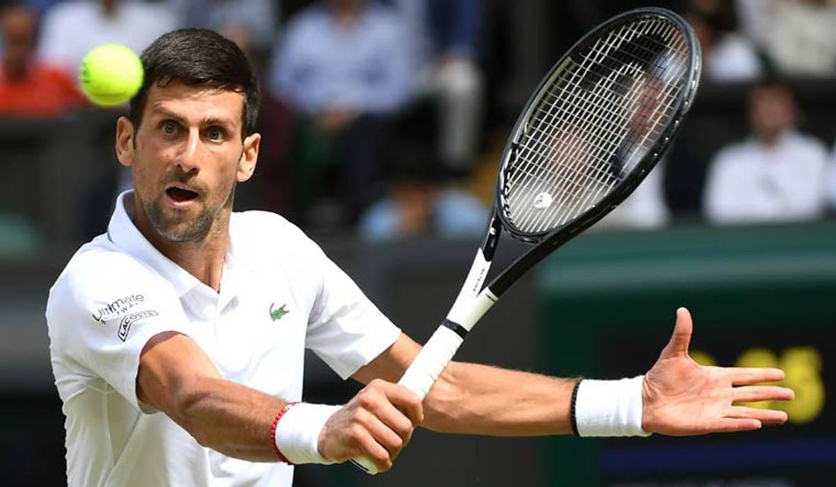 Djokovic playing a backhand shot on his way to sixth Wimbledon final.