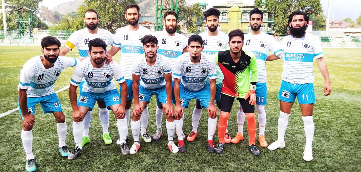 Winners posing for a group photograph during JKFA Annual League Football Tournament in Srinagar.