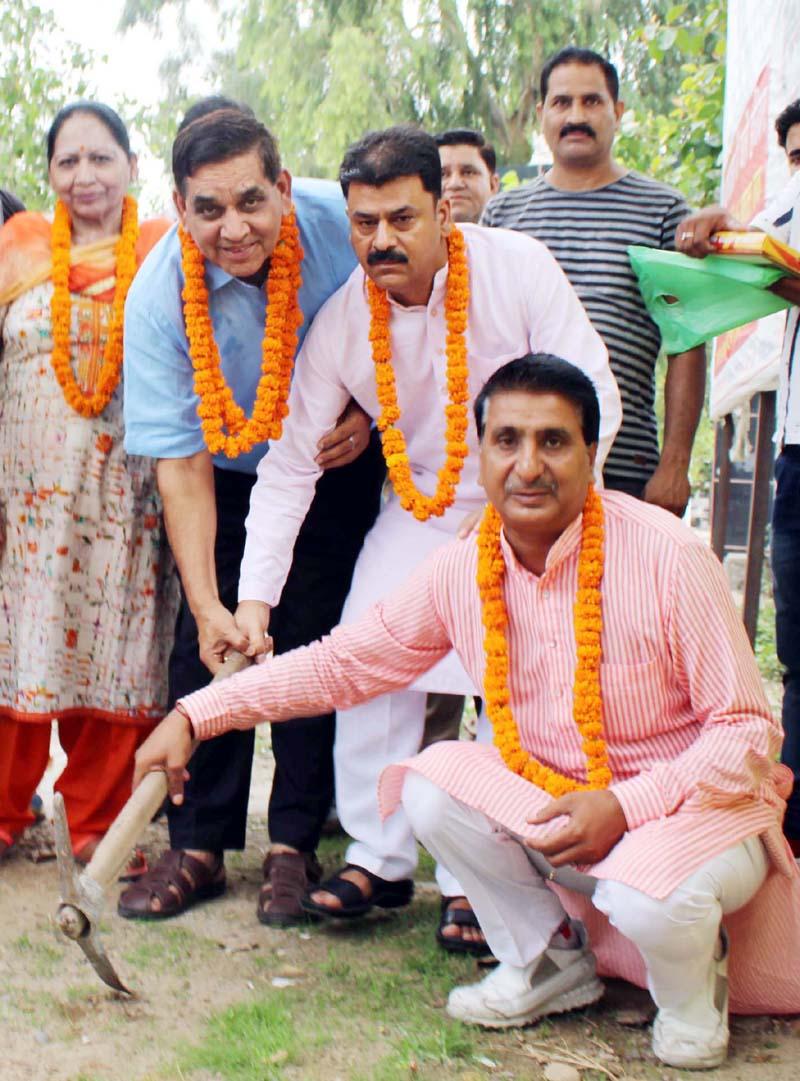 Mayor JMC, Chander Mohan Gupta starting tile work at Shakti Nagar Cremation Ground on Monday.