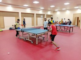 Players in action during a TT match of Inter-school tournament in Jammu on Tuesday.