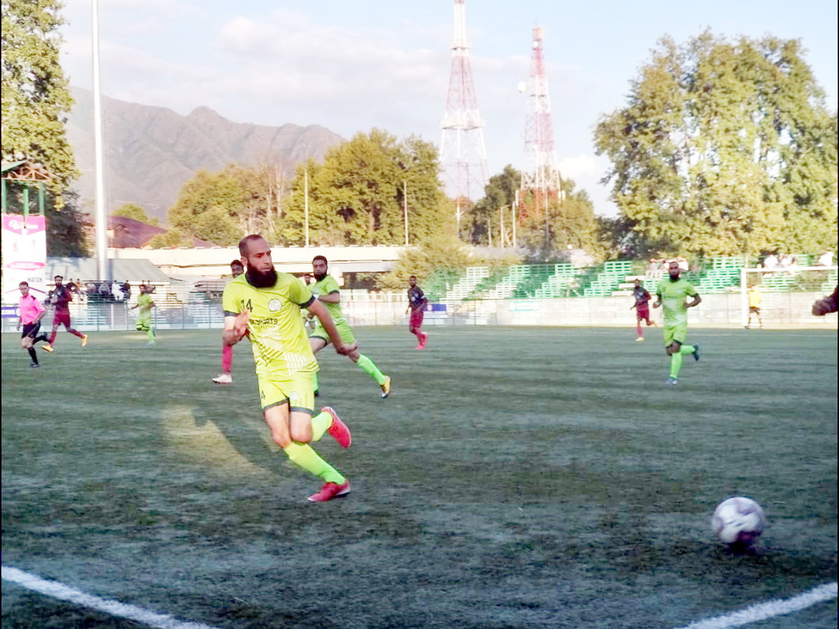 Footballers in action during a match of JKFA's league tournament in Srinagar.